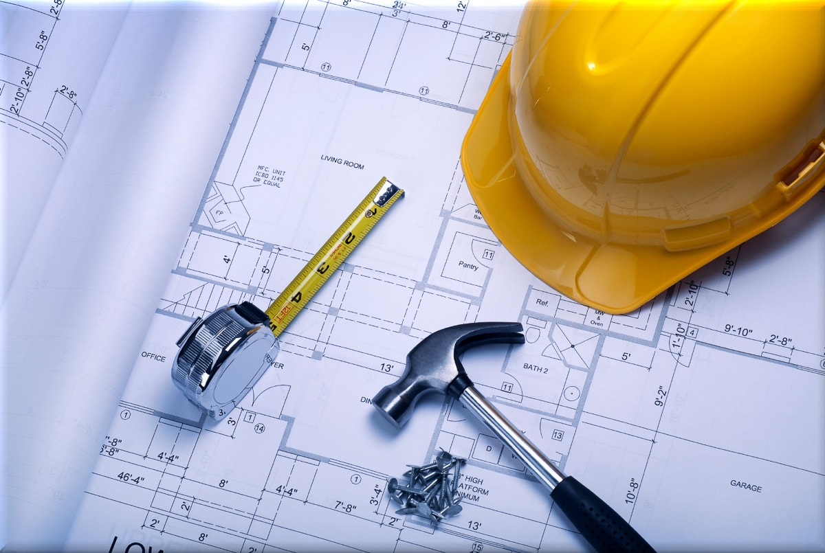 Hard hat and construction plans